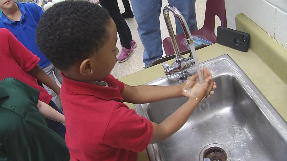 Student washing hands during Louisville Water Company's hand-washing blitz (Jan. 15, 2020)
