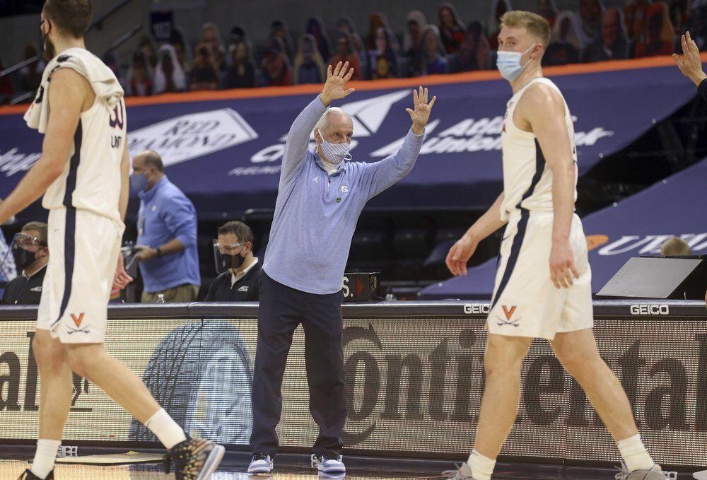 North Carolina coach Roy Williams waves goodbye