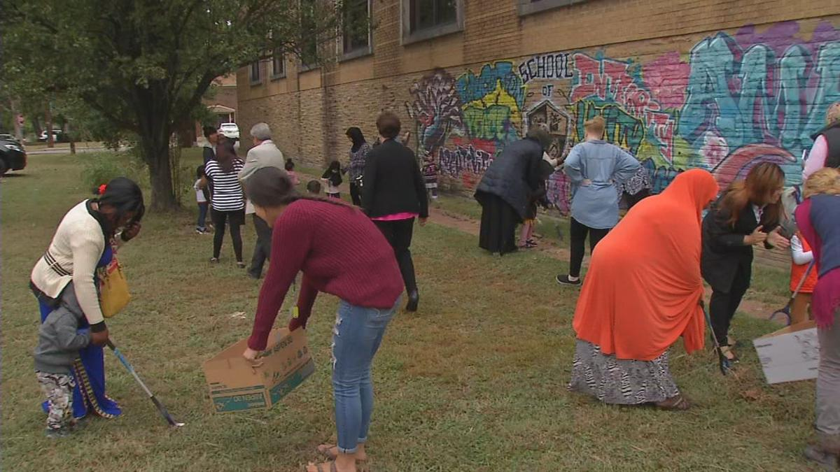 Immigrants performing a service project at Americana Community Center
