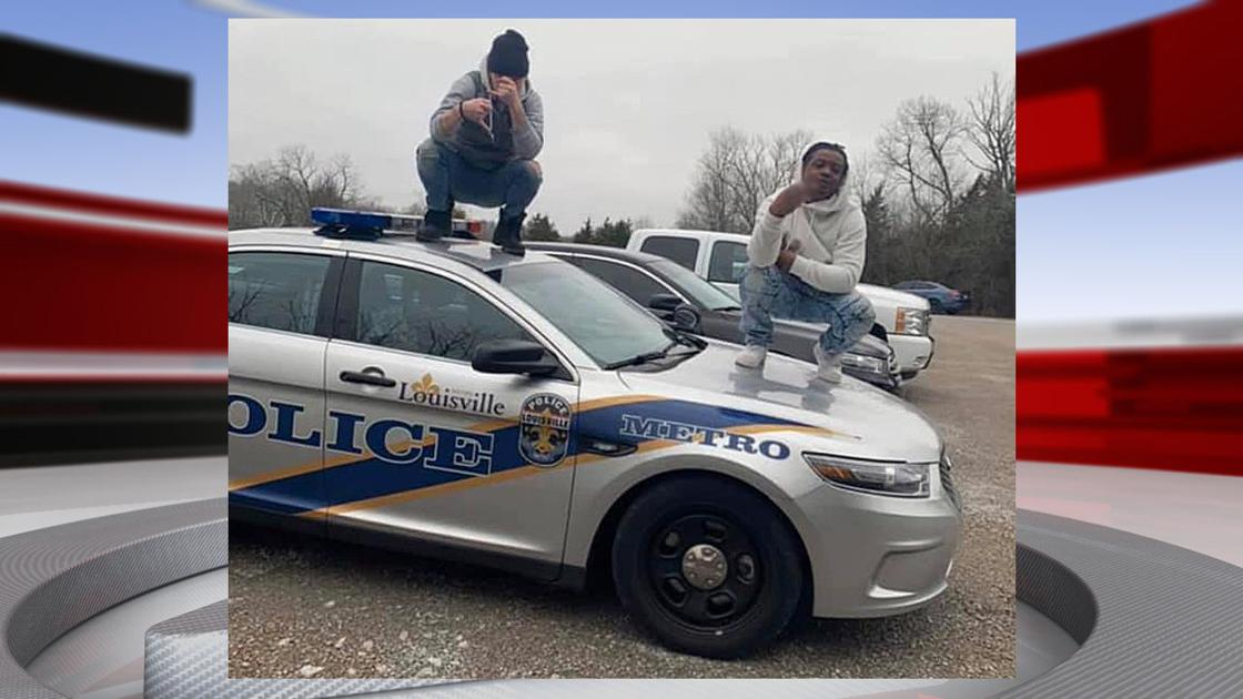 WANTED: Authorities looking for 2 people photographed standing on LMPD cruiser