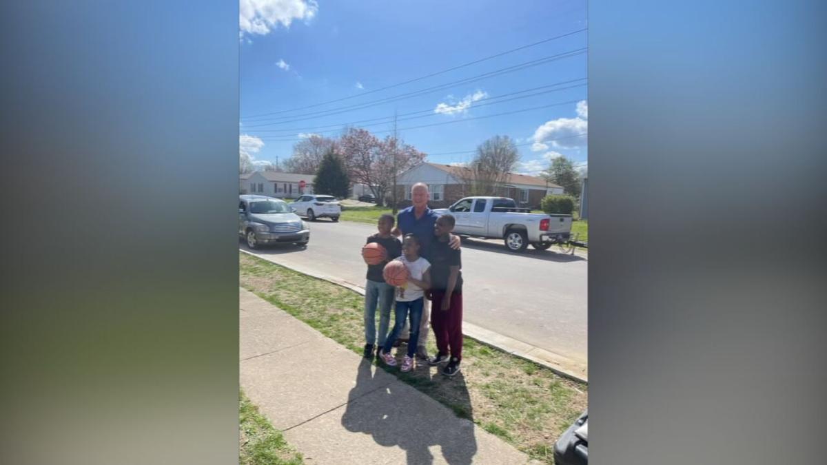 Jeffersonville mayor, police donate basketball goal-pickup game (2).jpeg