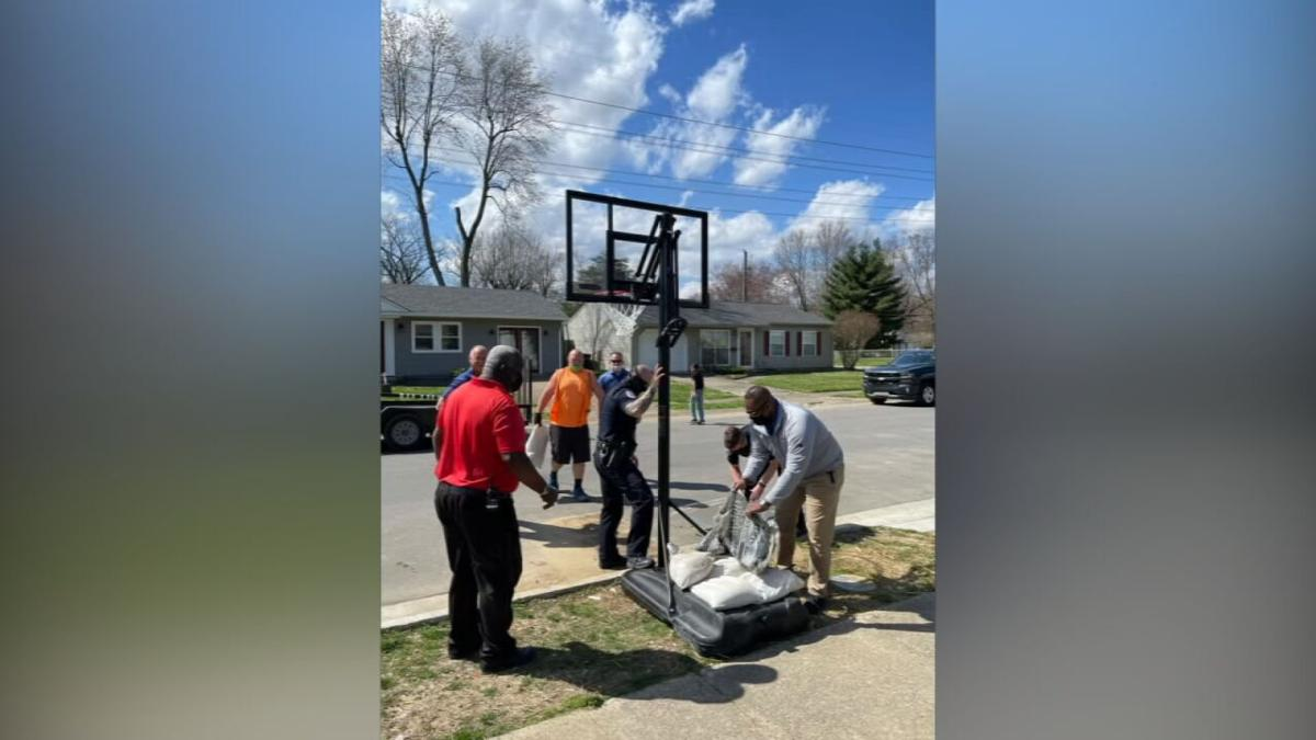 Jeffersonville mayor, police donate basketball goal-pickup game.jpeg