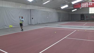 Special Olympics athlete returns to tennis court with prosthetic leg made in Louisville