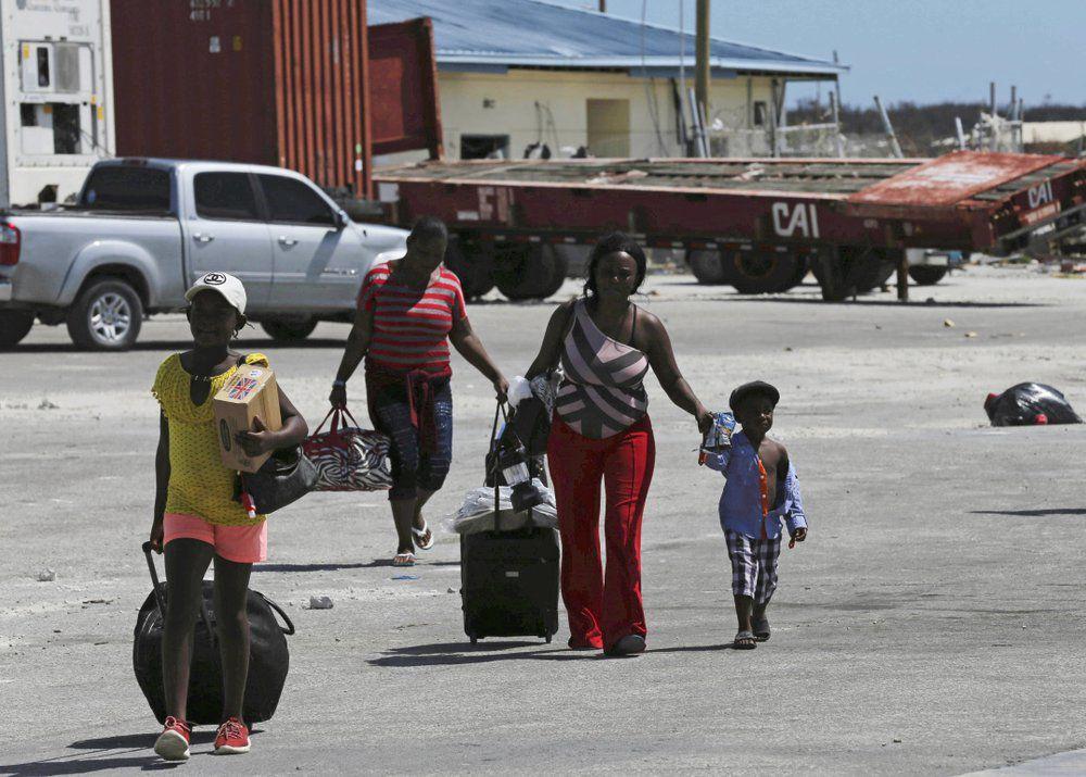 Dorian Bahamas Evacuees walk to ferry