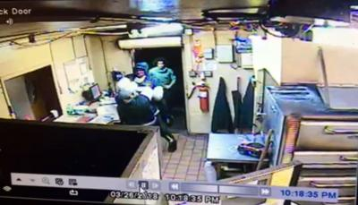 VIDEO | 2 men arrested after security video shows robbery at Sellersburg pizza shop