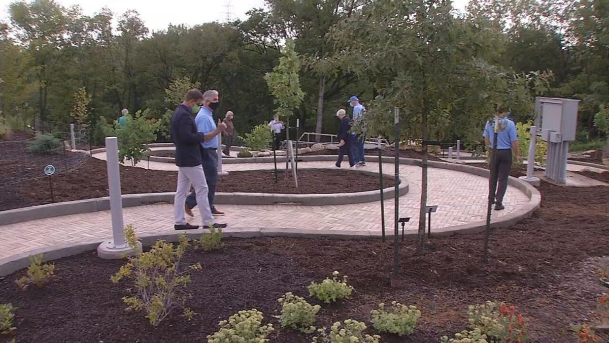 People walk on Beargrass path at Waterfront Botanical Gardens