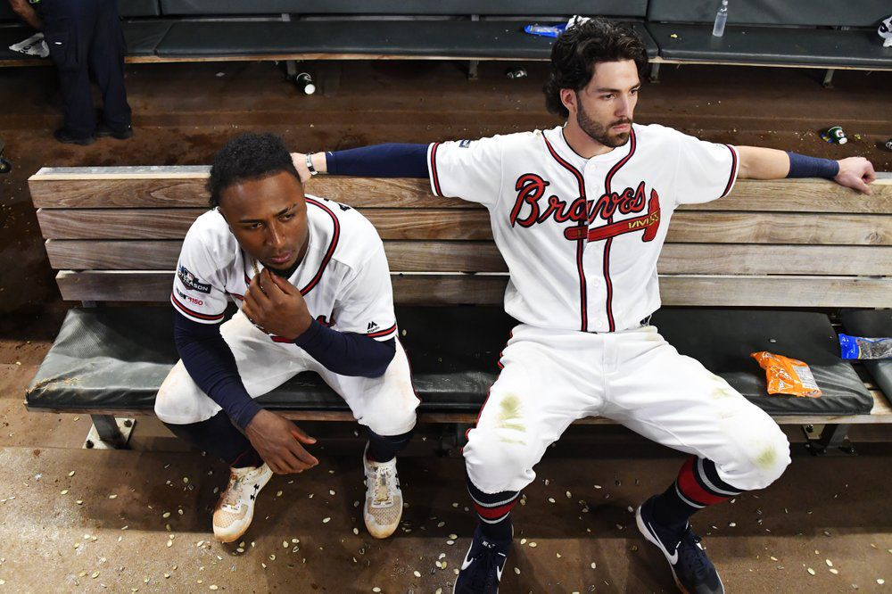 Atlanta Braves' Dansby Swanson, right, and Ozzie Albies