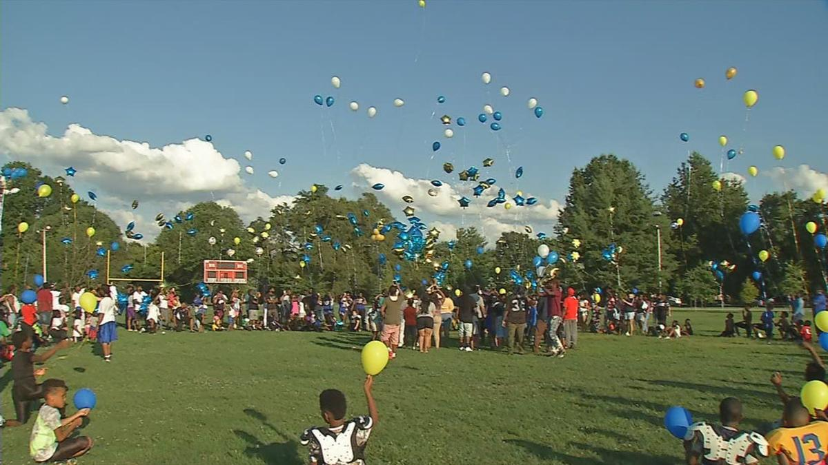 Rams Youth Football team releases balloons in honor of Coach O