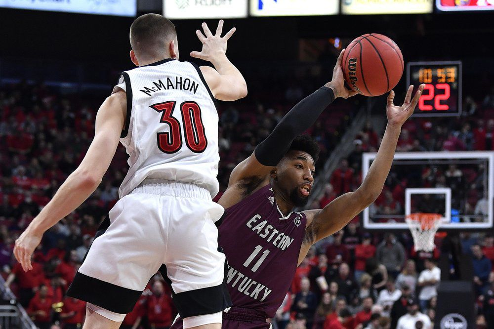Eastern Kentucky guard Jomaru Brown (11) attempts to pass the ball as Louisville guard Ryan McMahon