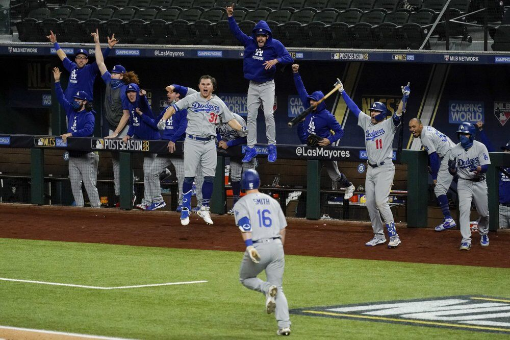The Los Angeles Dodgers celebrate a three-run home run by Will Smith
