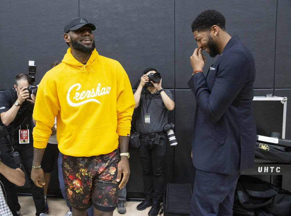 LeBron James, left, shares a moment with Anthony Davis