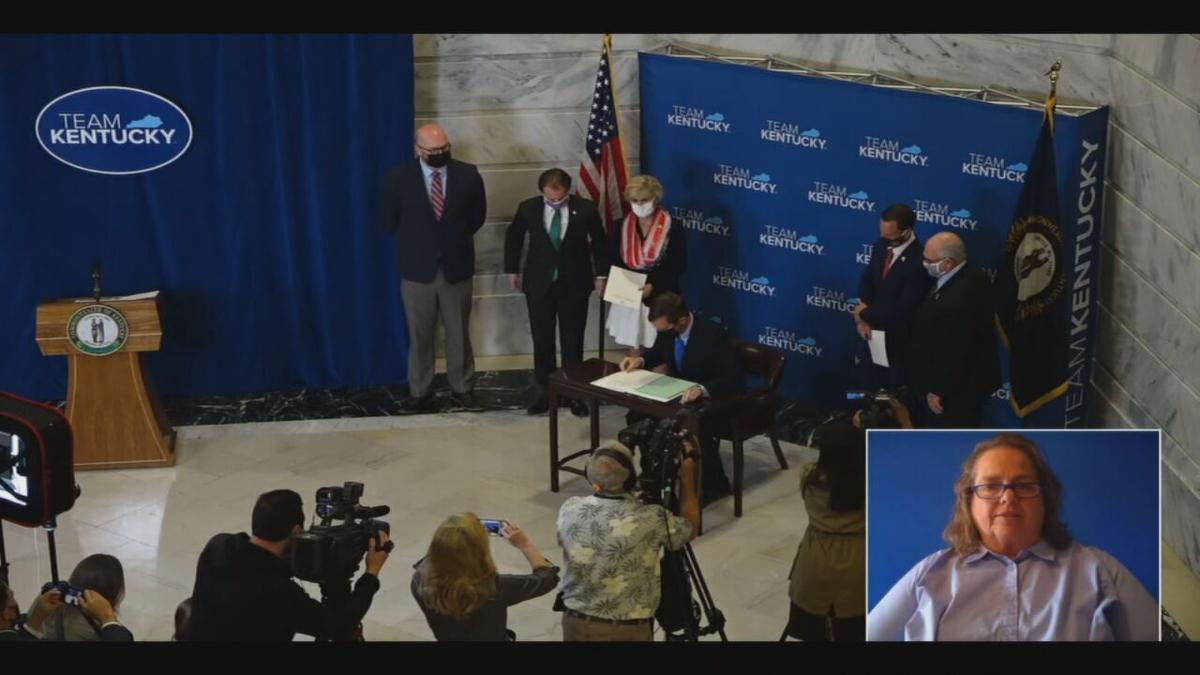 Kentucky Gov. Andy Beshear signs bi-partisan election reform bill on April 7, 2021