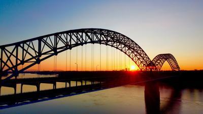 Sherman Minton Bridge with sunrise in background