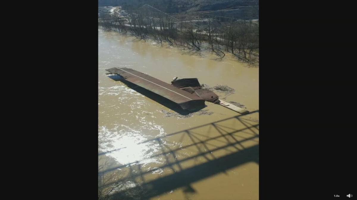 Marina floats down Kentucky River-Flooding-3-3-21.jpeg