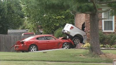 Neighbor pulls road rage suspect and victims from wreck after vehicles crash into homes