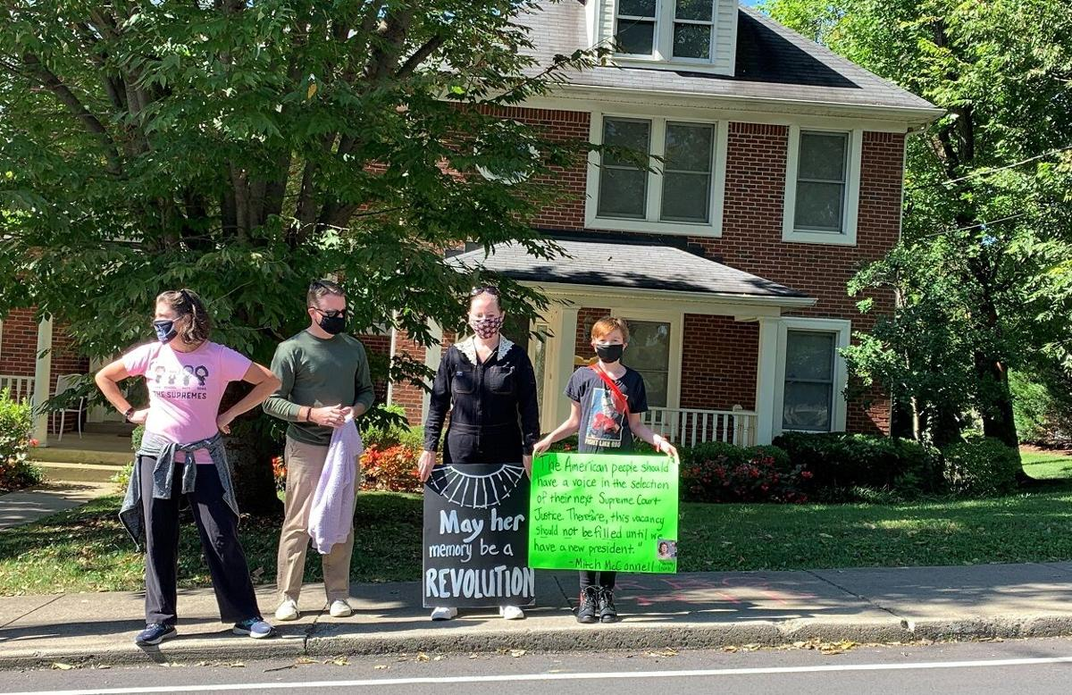 Protesters outside Mitch McConnell's home with signs