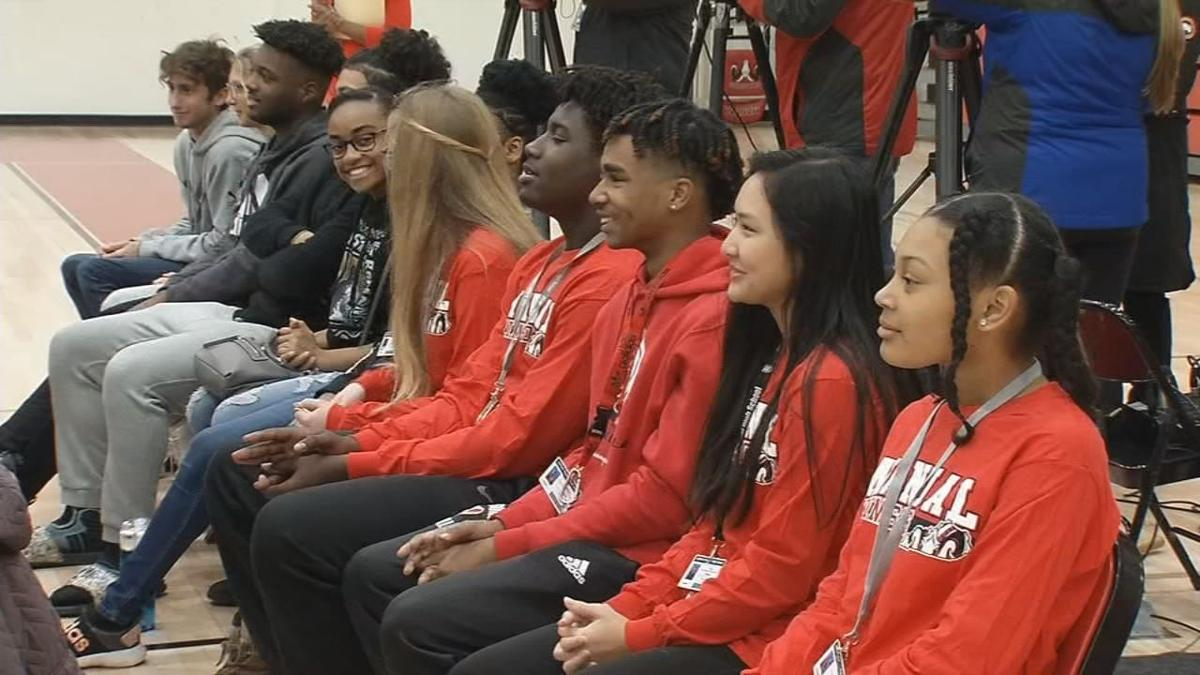 Audience members watch as Manual HS's Class of '76 unveils donation for Sports and Learning Complex