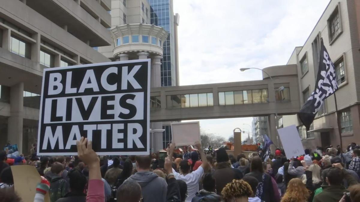 Protesters march through Louisville, Ky., on Saturday, March 13, 2021