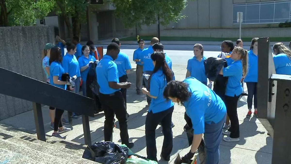 Volunteers prep for street clean up