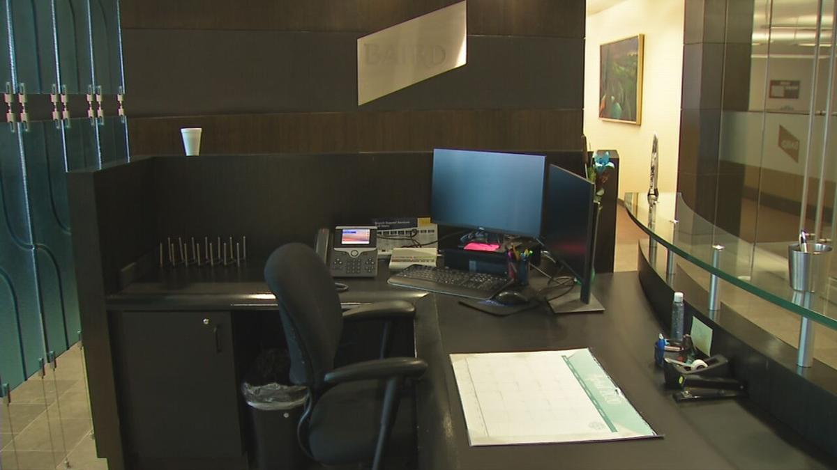 Empty employee desk in office building (generic)