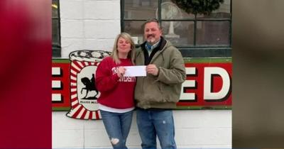 Woodford County, Ky. cattle farmer Greg Dotson presenting check (Dec. 2020)