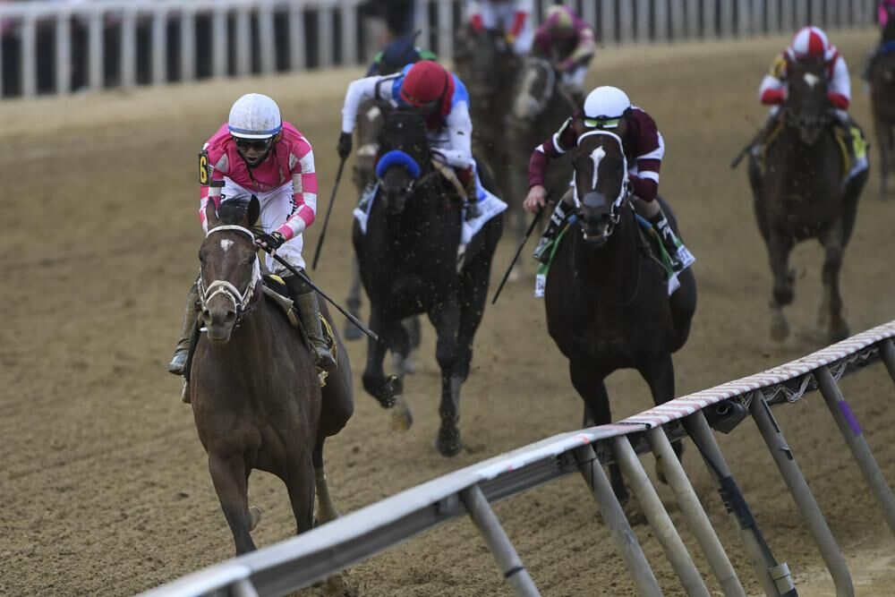 Flavien Prat atop Rombauer, left, wins the 146th Preakness Stakes