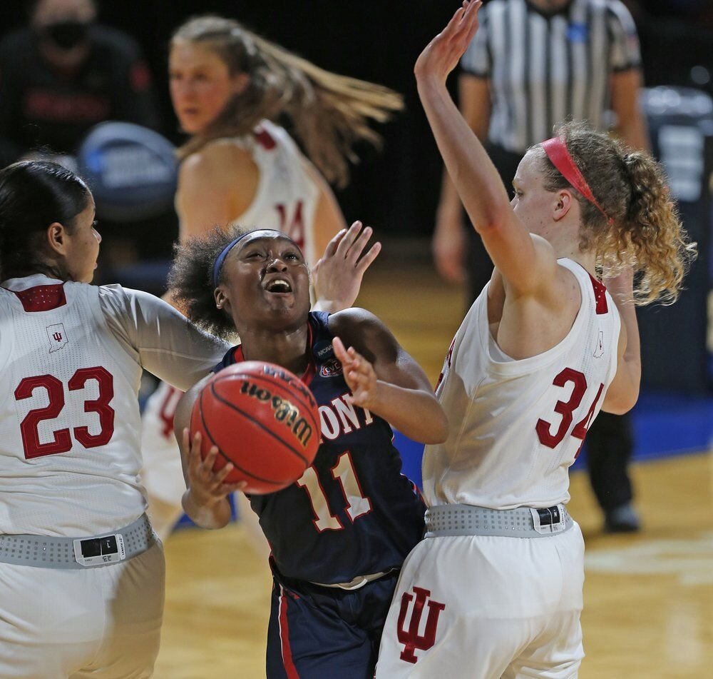 Belmont guard Destinee Wells (11) drives between Indiana guard Tori Campbell (23) and guard Grace Berger
