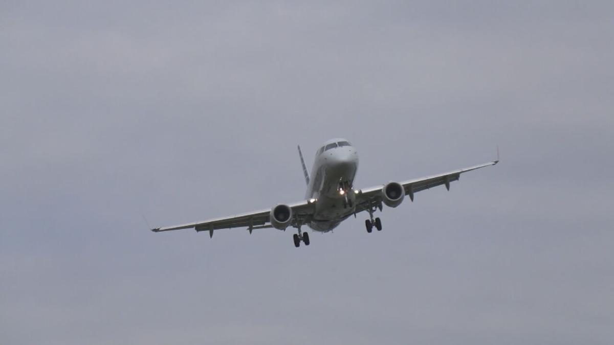 Plane flying through the air (generic)