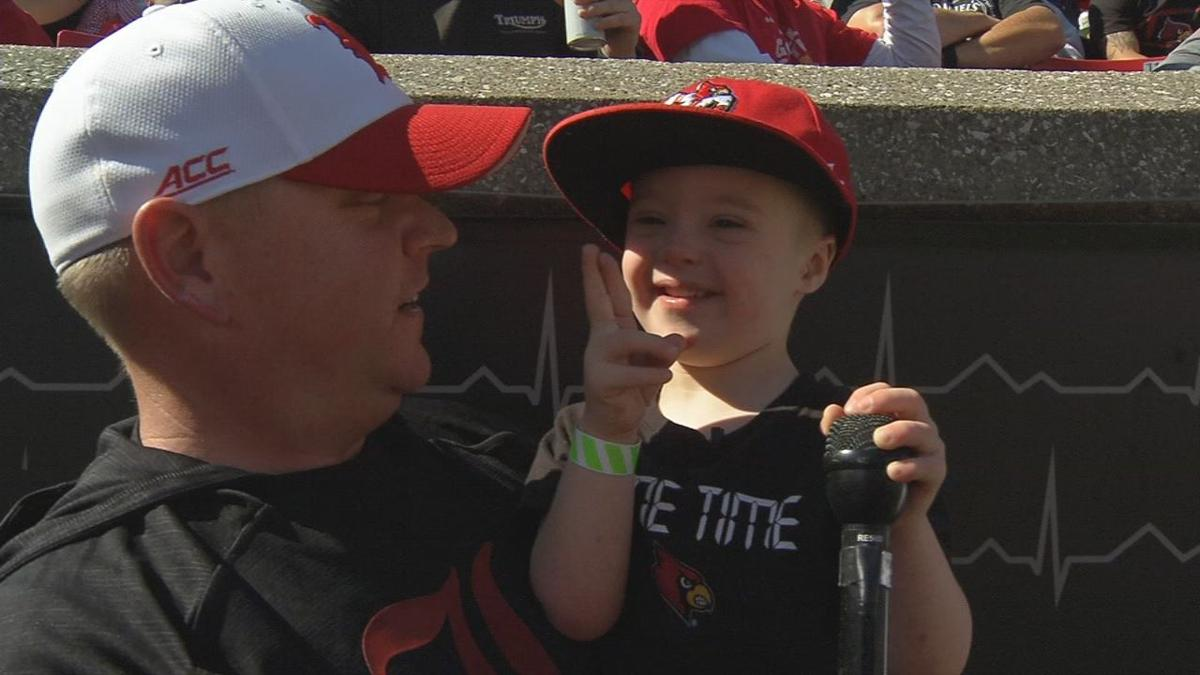 4-year-old boy with Down syndrome leads Cardinal Marching Band during halftime performance