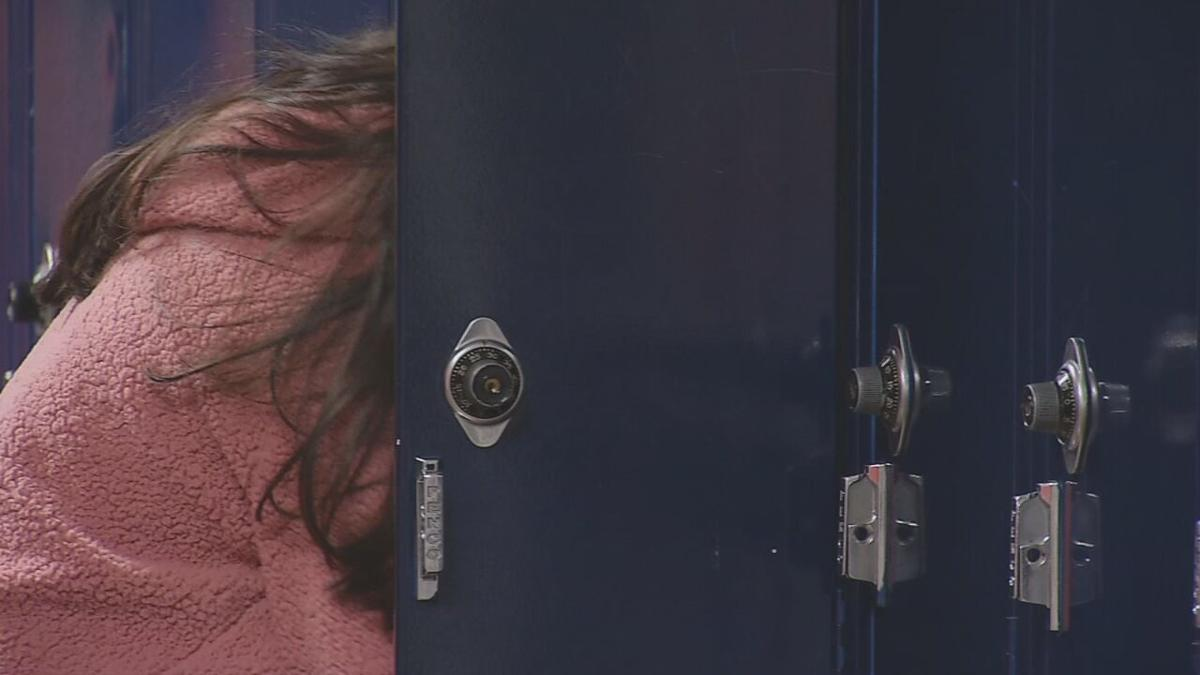 student at locker