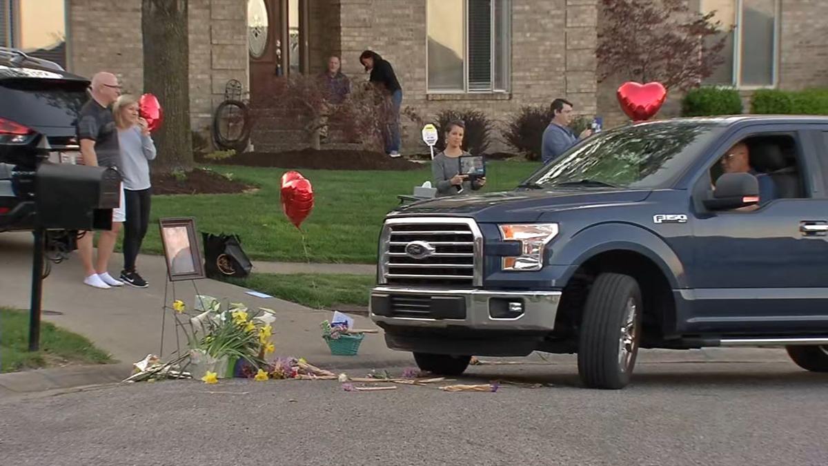 John Renn Jr. funeral drive-by driveway.jpg