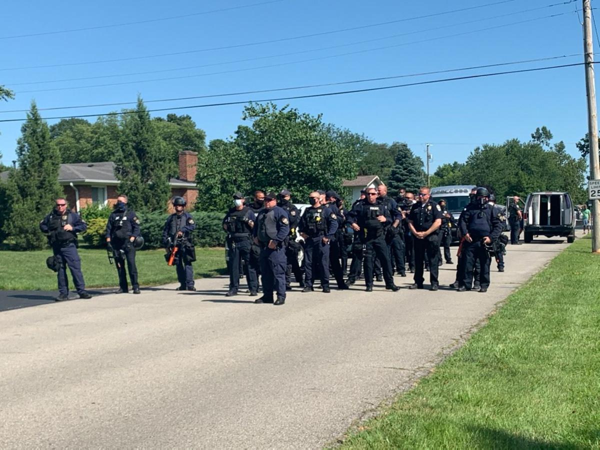 Police in east Louisville stand to meet Breonna Taylor protesters on Tuesday, July 14, 2020