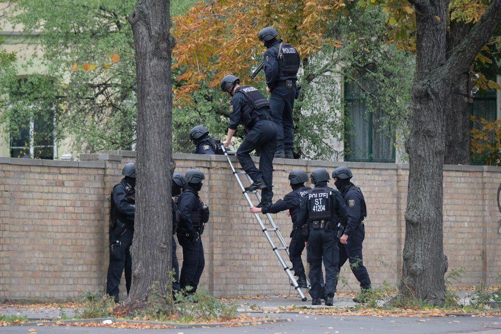 Halle Germany Shooting - police climb wall - 10-9-19