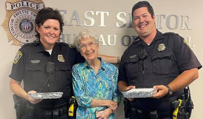 Lexington Police with Miss Robinson and her cookies