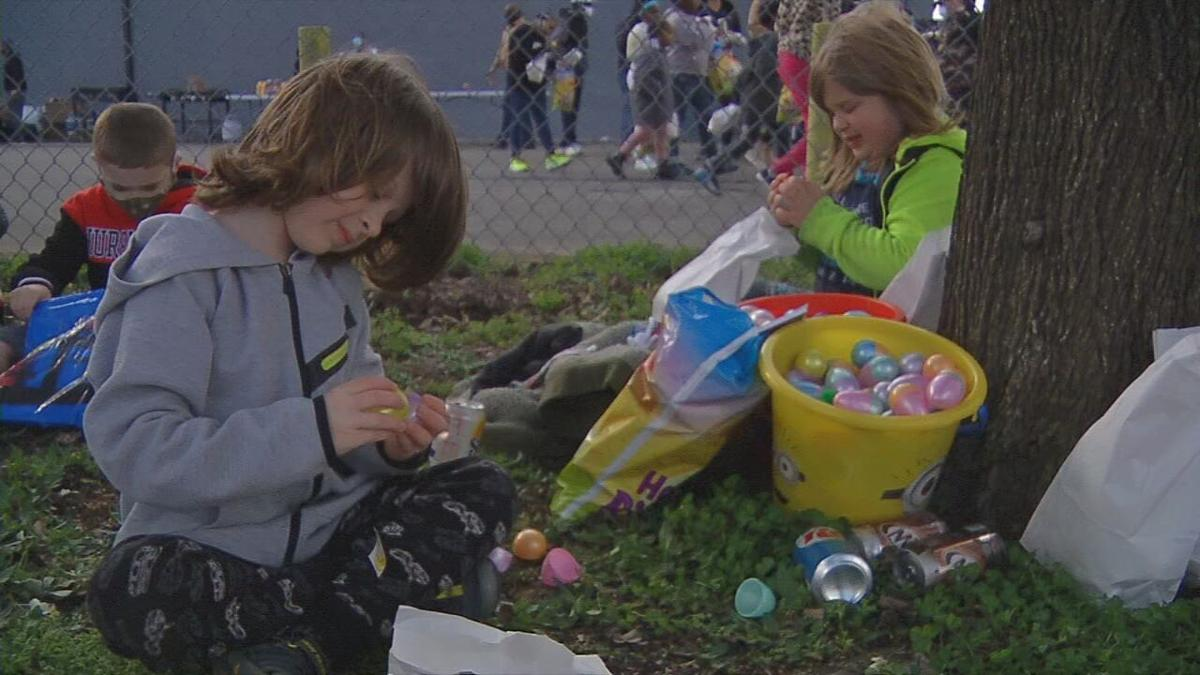 Children open up Easter eggs.jpeg