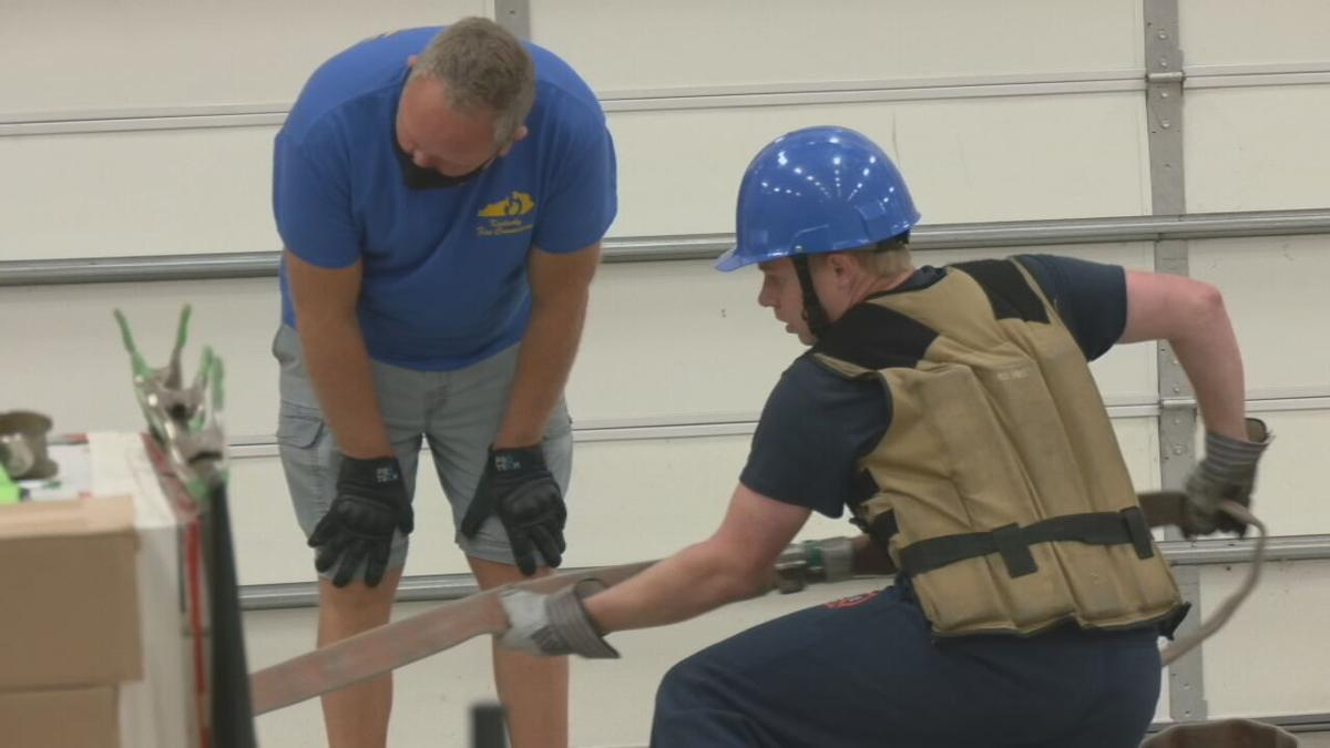 Prospective firefighters take physical agility test in Louisville on Oct. 12, 2021