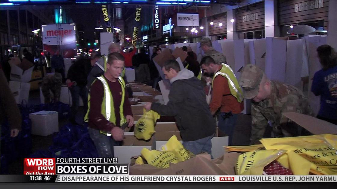 Volunteers pack 'Boxes of Love' at 4th Street Live! for