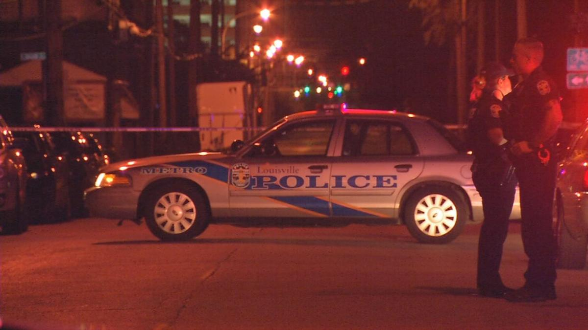 LMPD vehicle in front of crime scene tape at night