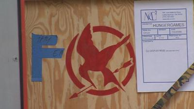 Semi trucks carrying 'Hunger Games' exhibit arrive in Louisville