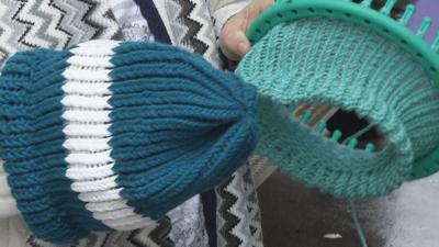 Woman donates 100 knit hats to homeless