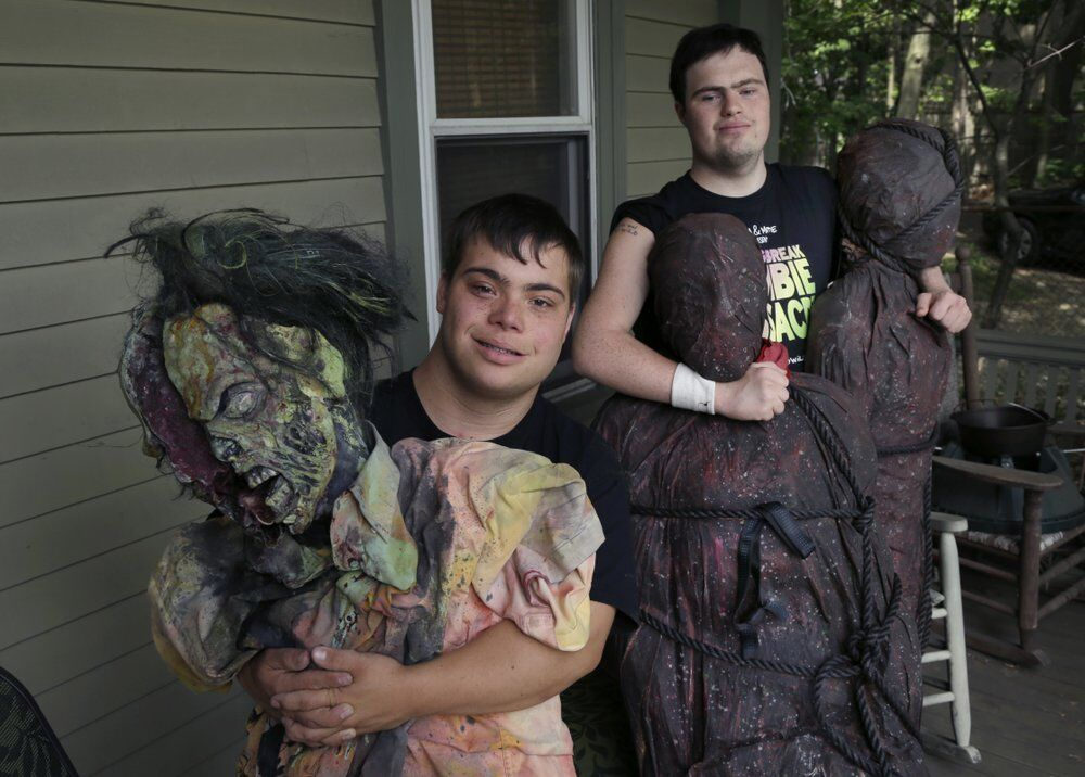 Zombie filmmakers with props