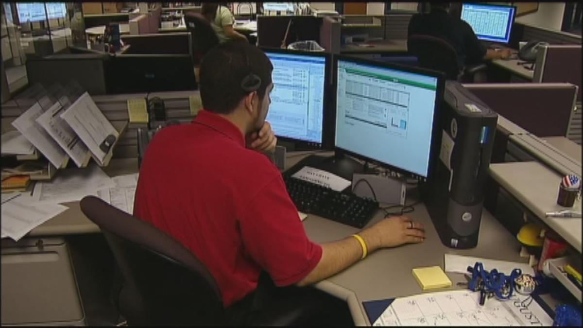 WORK - MAN AT A COMPUTER - VIA FOX .jpg