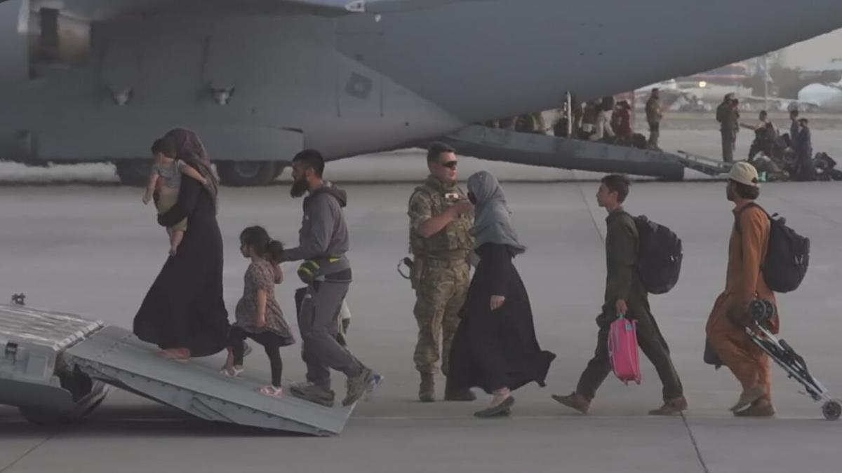 Afghan refugees board a US military aircraft in Kabul, Afghanistan