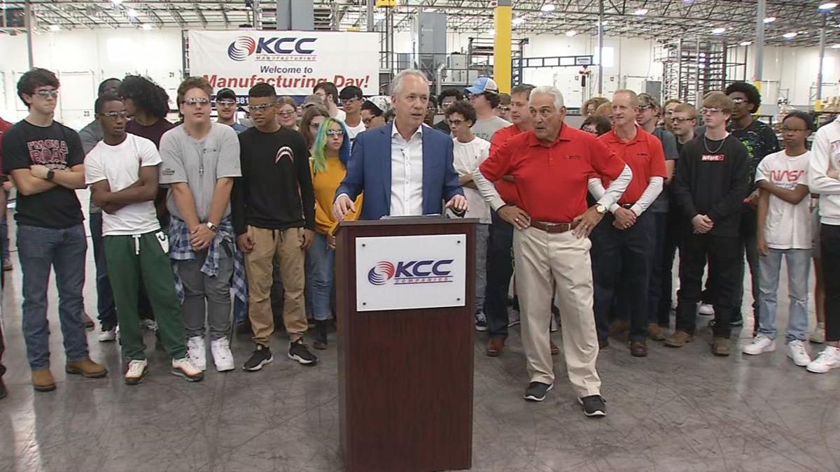 Fischer at podium manufacturing day