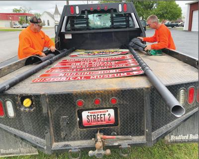 - City employees remove damaged sign