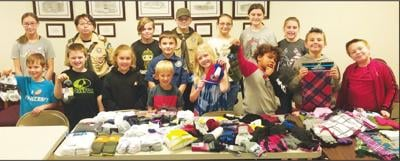 """- Seymour's Cub Scout Troop 91 gathered 98 items  or """"Socktober"""""""
