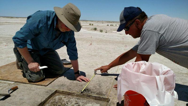 Archaeologist Daron Duke (L) and colleague Michael Shane work