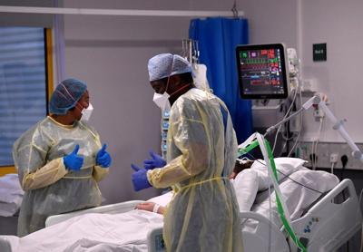 FILE PHOTO: Medical staff treat seriously ill COVID-19 patients at Milton Keynes University Hospital, amid the spread of the coronavirus disease (COVID-19) pandemic, Milton Keynes