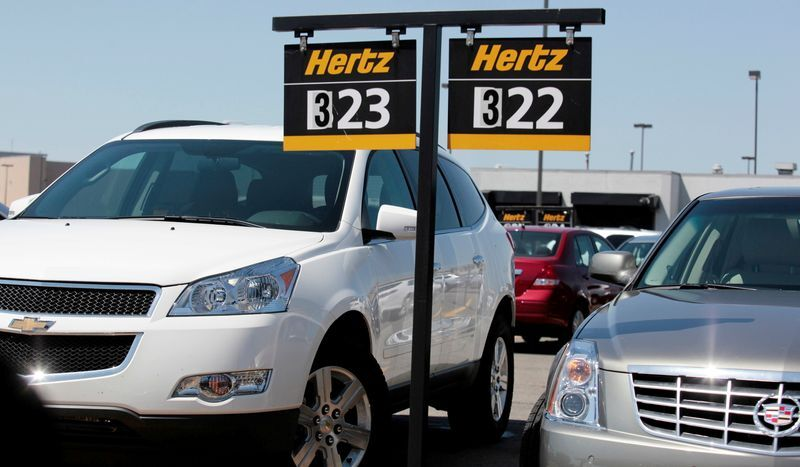 FILE PHOTO: FILE PHOTO: Hertz rental cars are parked in a rental lot near Detroit Metropolitan airport in Romulus