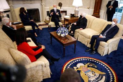 U.S. President Joe Biden and U.S. Vice President Kamala Harris, accompanied by U.S. Treasury Secretary Janet Yellen attend a meeting with business leaders at the Oval Office of the White House in Washington